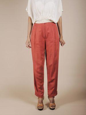 Pantaloni a vita alta in seta color mattone
